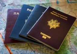 101182417_F5F46N_A_selection_of_international_passports_sitting_on_a_map-large