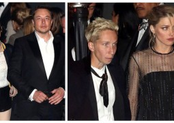 49E3298100000578-5465017-Back_in_the_game_Elon_arrived_to_the_Oscar_party_with_a_mystery_-a-1_1520279026054_副本