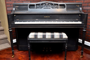 Yamaha Console Upright piano refinished in a tasteful ebony satin