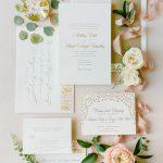 Gold blind letterpress Wedding invitation calligraphy stationery flatlay RO & Co. Events Destination Wedding Planner