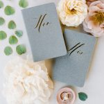 Wedding vow books and rings flatlay RO & Co. Events Destination Wedding Planner