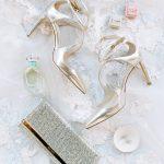 Wedding bride accessories flatlay Jimmy Choo The Mrs. Box RO & Co. Events Destination Wedding Planner