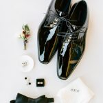 Wedding groom accessories details flatlay with boutonniere RO & Co. Events Destination Wedding Planner