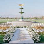 wedding ceremony floral aisle Empire Polo Club chameleon chair RO & Co. Events Destination Wedding Planner