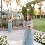 Wedding Ceremony floral aisle blue bridesmaid dress Empire Polo Club RO & Co. Events Destination Wedding Planner