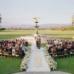 Wedding Ceremony in the round bride and groom floral aisle Empire Polo Club RO & Co. Events Destination Wedding Planner