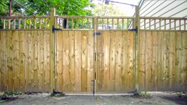 Building a privacy fence with a double gate.