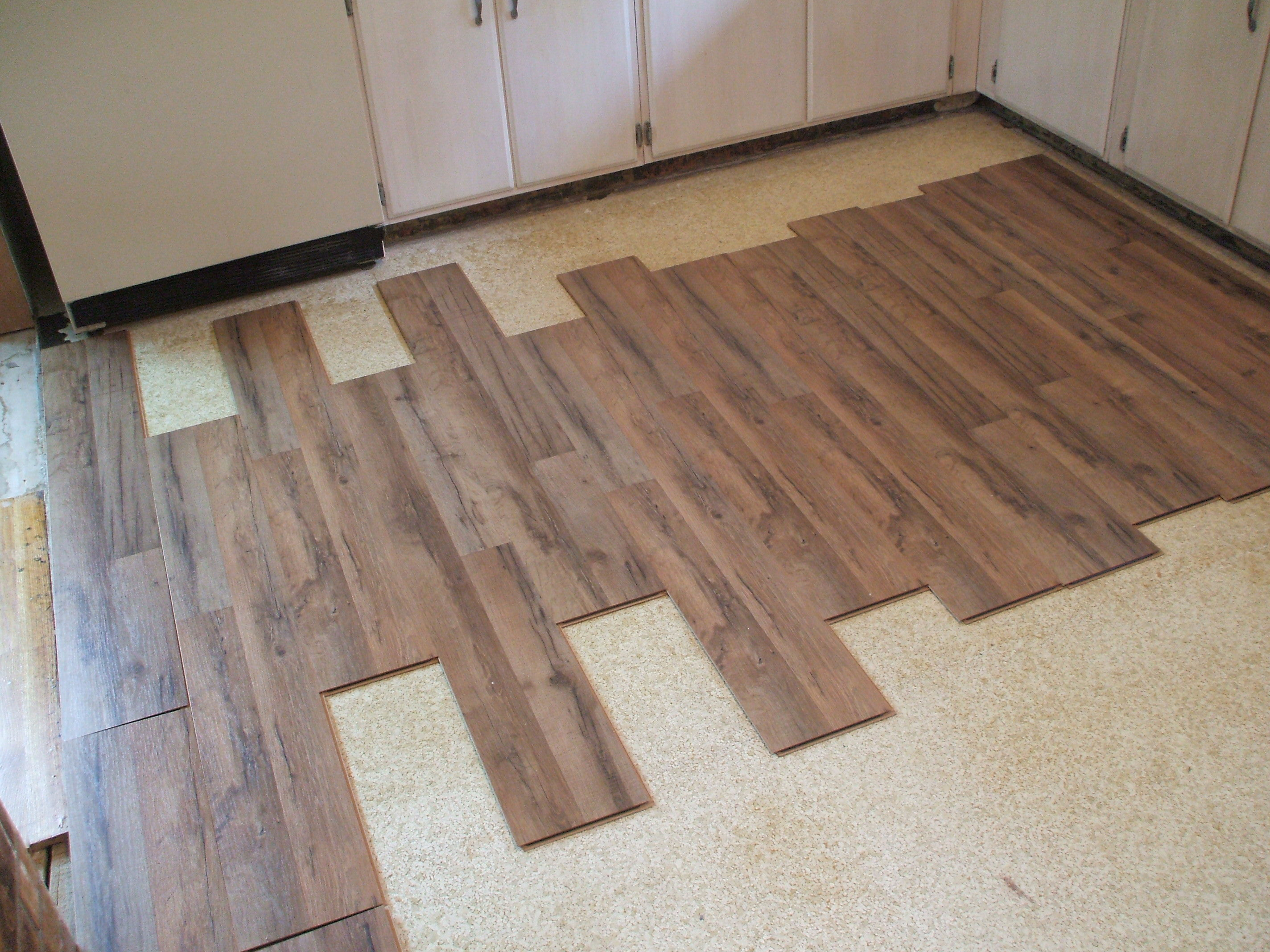 Kitchen Tile Laminate Flooring Flooring Options For Your Rental Home Which Is Best