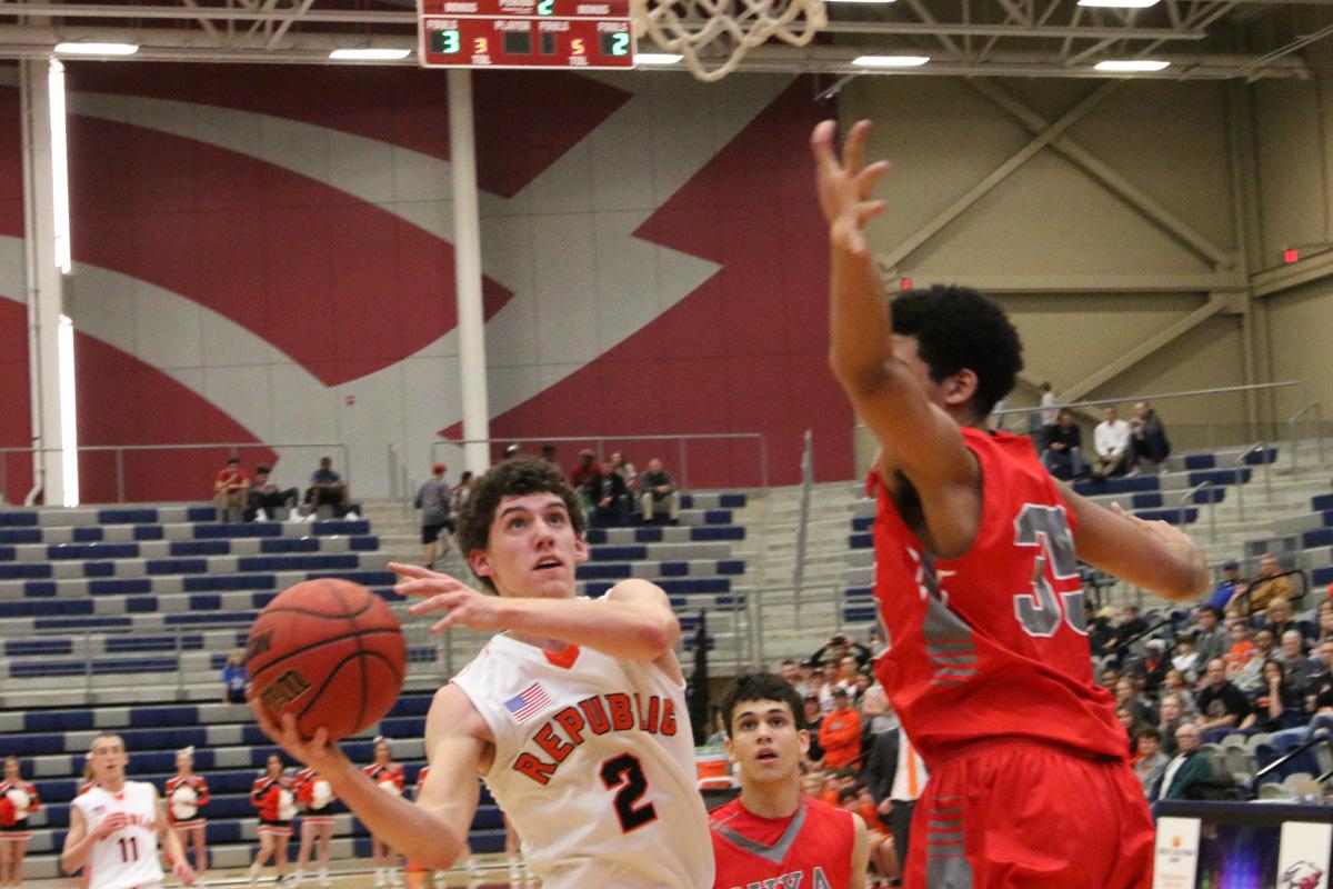 Photos: Varsity Boys Basketball Vs Nixa (Districts)