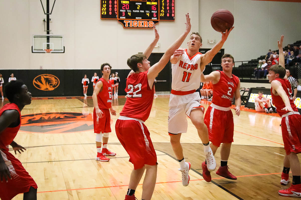 Photos: Varsity Boys Basketball Vs Carl Junction