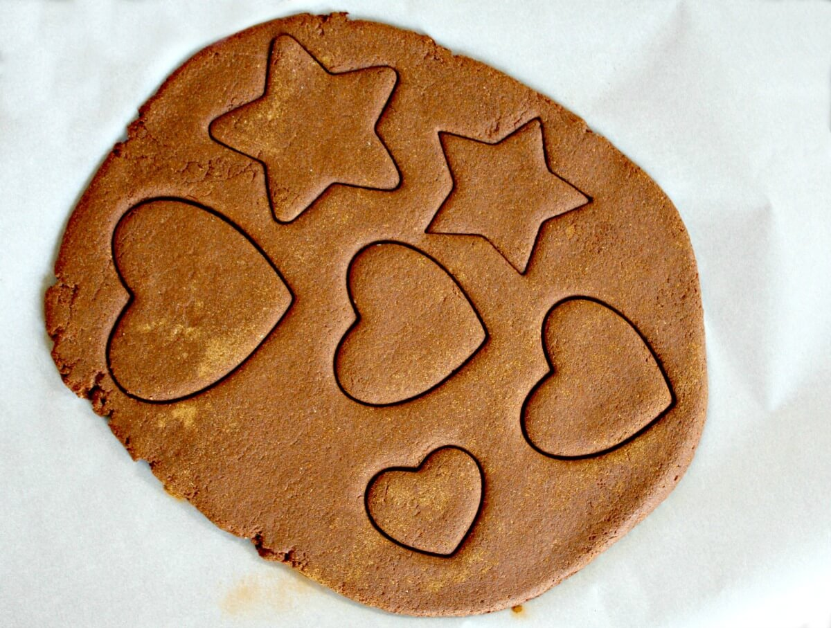 cut shapes in the cinnamon ornament dough for holiday decor