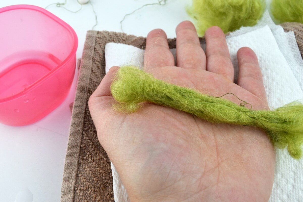 Roll yarn with water to create faux fur or hair for a female gnome
