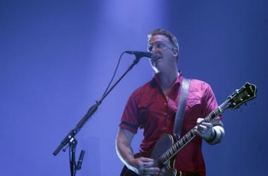 Josh Homme of Queens of the Stone Age performing live on stage at Wembley Arena in London