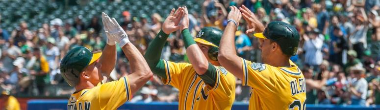 A's top O's to earn series split