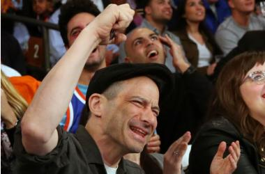American recording artist Adam Horovitz of the Beastie Boys sits court side at the game between the New York Knicks and the Philadelphia 76ers at Madison Square Garden