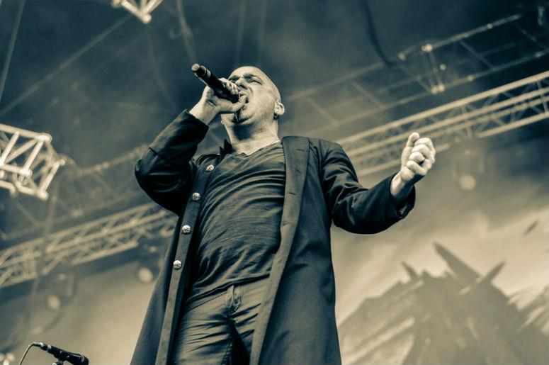 Disturbed is an American rock band that formed when guitarist Dan Donegan, drummer Mike Wengren and bassist Steve Fuzz Kmak hired vocalist David Draiman in 1996.