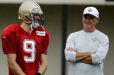 Jul 29, 2017; Metairie, LA, USA; New Orleans Saints quarterback Drew Brees (9) talks with general manager Mickey Loomis on the sideline during training camp at the Metairie Training Facility.