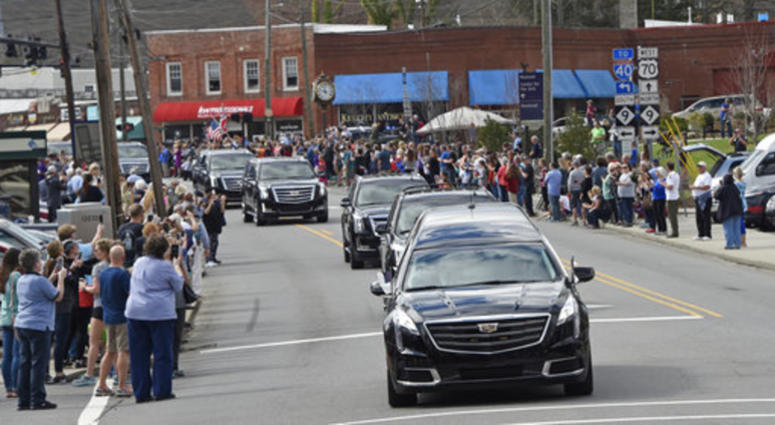 Admirers line streets, overpasses to see Graham's motorcade