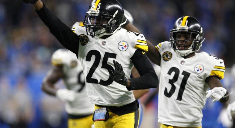 Oct 29, 2017; Detroit, MI, USA; Pittsburgh Steelers cornerback Artie Burns (25) celebrates with defensive back Mike Hilton (31) after picking up a fumble during the fourth quarter against the Detroit Lions at Ford Field.