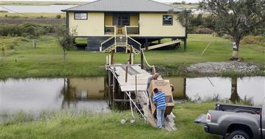As Louisiana island shrinks, state paying to move residents