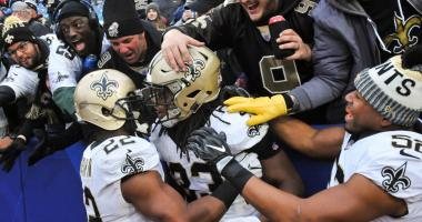 Nov 12, 2017; Orchard Park, NY, USA; New Orleans Saints running back Trey Edmunds (33) is embraced by running back Mark Ingram (22), outside linebacker Craig Robertson (52) and Saints fans after scoring a touchdown during the fourth quarter of a game agai