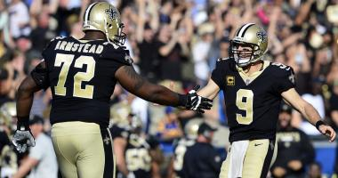 November 26, 2017; Los Angeles, CA, USA; New Orleans Saints quarterback Drew Brees (9) celebrates with offensive tackle Terron Armstead (72) after running back Alvin Kamara (41) scores a touchdown against the Los Angeles Rams during the first half at the