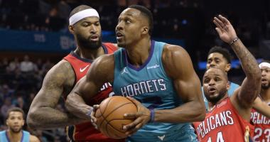 Holiday lifts Pelicans past Hornets 101-96