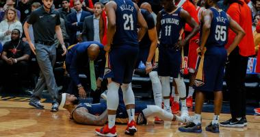 Jan 26, 2018; New Orleans, LA, USA; New Orleans Pelicans center DeMarcus Cousins (0) lays on the ground after suffering an apparent injury during the fourth quarter against the Houston Rockets at the Smoothie King Center. Pelicans defeated the Rockets 115