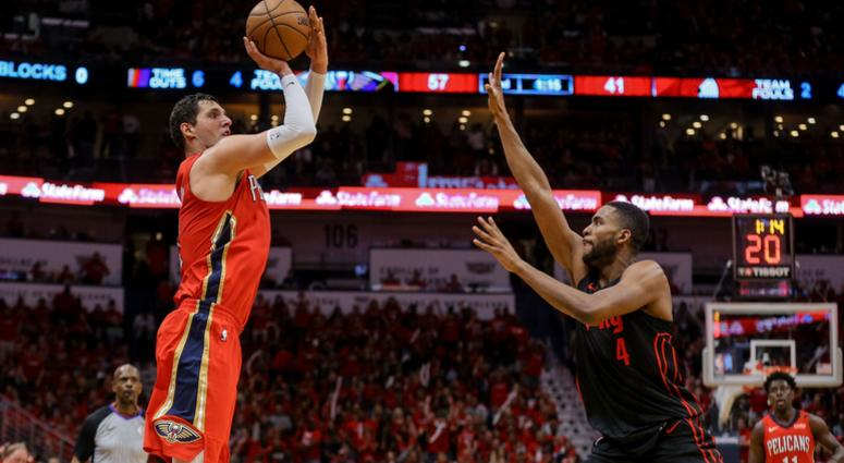 Apr 19, 2018; New Orleans, LA, USA; New Orleans Pelicans forward Nikola Mirotic (3) shoots over Portland Trail Blazers forward Maurice Harkless (4) during the second quarter in game three of the first round of the 2018 NBA Playoffs at the Smoothie King Ce