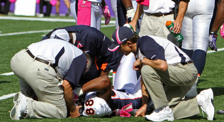 Denver Broncos Demaryius Thomas (88) is treated by medical staff after suffering a concussion during the game against the Baltimore Ravens at M&T Bank Stadium.