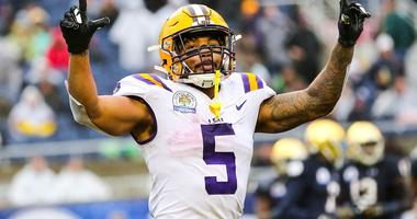 Jan 1, 2018; Orlando, FL, USA; LSU Tigers running back Derrius Guice (5) celebrates after scoring a touchdown against the Notre Dame Fighting Irish in the 2018 Citrus Bowl at Camping World Stadium.
