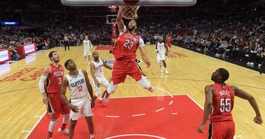 Apr 9, 2018; Los Angeles, CA, USA; New Orleans Pelicans forward Anthony Davis (23) shoots the ball as LA Clippers forward Montrezl Harrell (5) defends during an NBA basketball game at Staples Center. The Pelicans defeated the Clippers 113-100