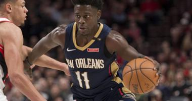 Apr 14, 2018; Portland, OR, USA; New Orleans Pelicans guard Jrue Holiday (11) drives past Portland Trail Blazers guard Wade Baldwin IV (2) during the first half in game one of the first round of the 2018 NBA Playoffs at Moda Center.