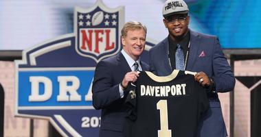 Apr 26, 2018; Arlington, TX, USA; NFL commissioner Roger Goodell with Marcus Davenport as selected as the number fourteen overall pick to the Tampa Bay Buccaneers in the first round of the 2018 NFL Draft at AT&T Stadium