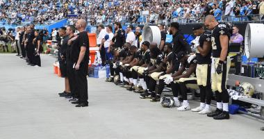Saints players sit during the national anthem in protest of racial inequality