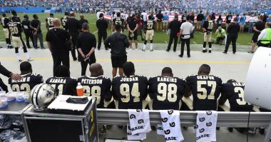 Sep 24, 2017; Charlotte, NC, USA; New Orleans Saints players sit during the national anthem at Bank of America Stadium.