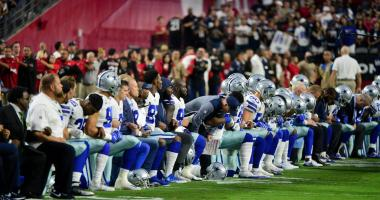 Sep 25, 2017; Glendale, AZ, USA; The Dallas Cowboys players, coaches and staff take a knee prior to the National Anthem before the game against the Arizona Cardinals at University of Phoenix Stadium.