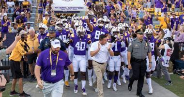 Sep 30, 2017; Baton Rouge, LA, USA; LSU Tigers head coach Ed Orgeron (white shirt) leads the team to the field before the game between the LSU Tigers and the Troy Trojans at Tiger Stadium.