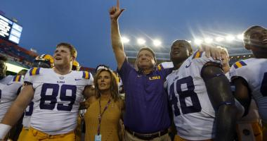 Oct 7, 2017; Gainesville, FL, USA; LSU Tigers head coach Ed Orgeron cheers with wide receiver Jonathan Giles (89) and linebacker Donnie Alexander (48) and teammates after beating the Florida Gators at Ben Hill Griffin Stadium.