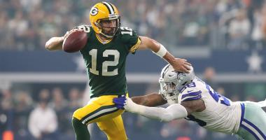 Oct 8, 2017; Arlington, TX, USA; Green Bay Packers quarterback Aaron Rodgers (12) scrambles away from Dallas Cowboys defensive end Damontre' Moore (58) in the third quarter at AT&T Stadium.