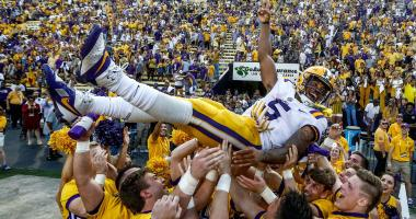 Oct 14, 2017; Baton Rouge, LA, USA; LSU Tigers running back Derrius Guice (5) is thrown into the air by LSU cheerleaders following a win against the Auburn Tigers in a game at Tiger Stadium. LSU defeated Auburn 27-23.