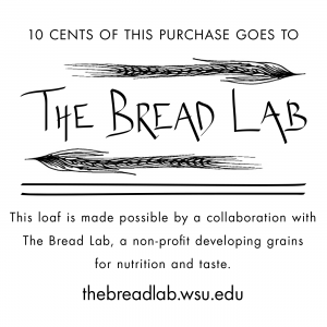 "Loaf label, ""10 cents of this purchase goes to The Bread Lab. This loaf is made possible by a collaboration with The Bread Lab, a non-profit developing grains for nutrition and taste. thebreadlab.wsu.edu"""