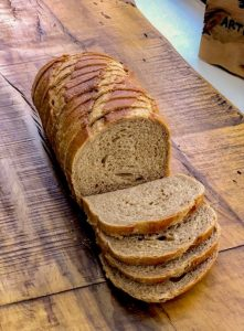 Sliced wheat bread on rustic table