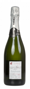 bottle of brut sparkling wine with illustration of the WSU Wine Science Center on the label