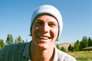 man wearing light blue beanie hat.