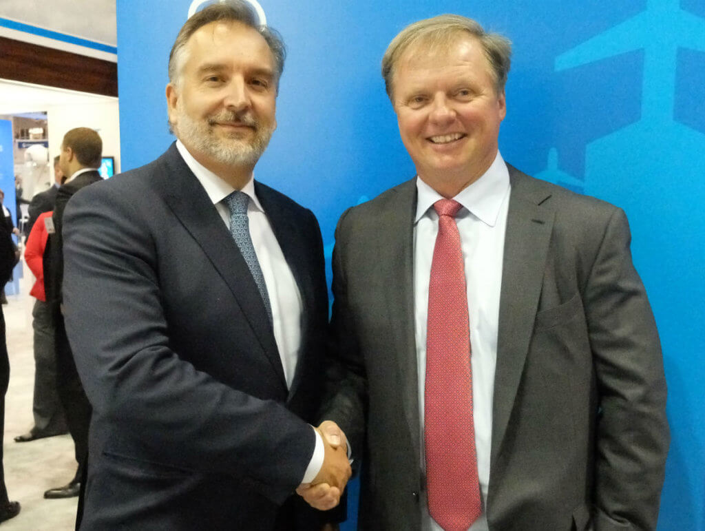Jim Jensen, founder and CEO of Satcom Direct, right, shakes hands with Mark van Berkel, president and CEO of TrueNorth Avionics, on the NBAA show floor. Ottawa-based TrueNorth has been acquired by Satcom Direct. Lisa Gordon Photo