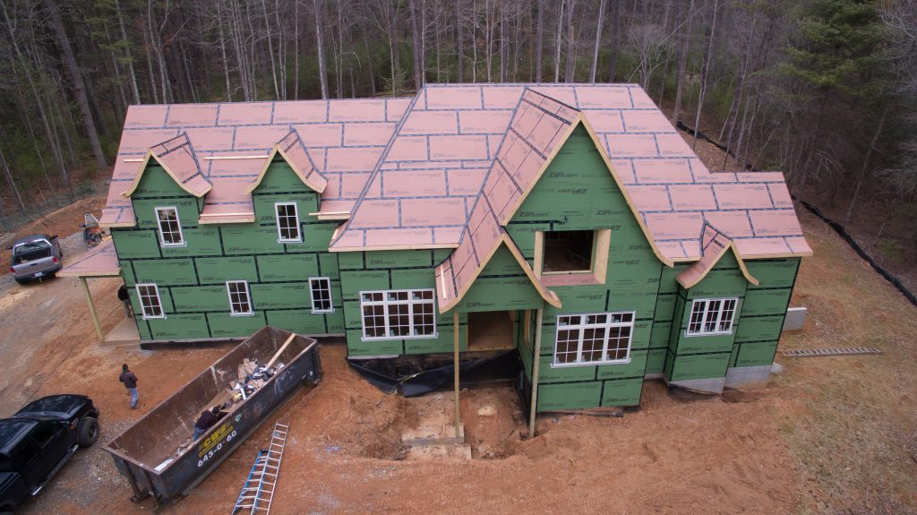 System replaces traditional sheathing and housewrap for Sheathing house wrap
