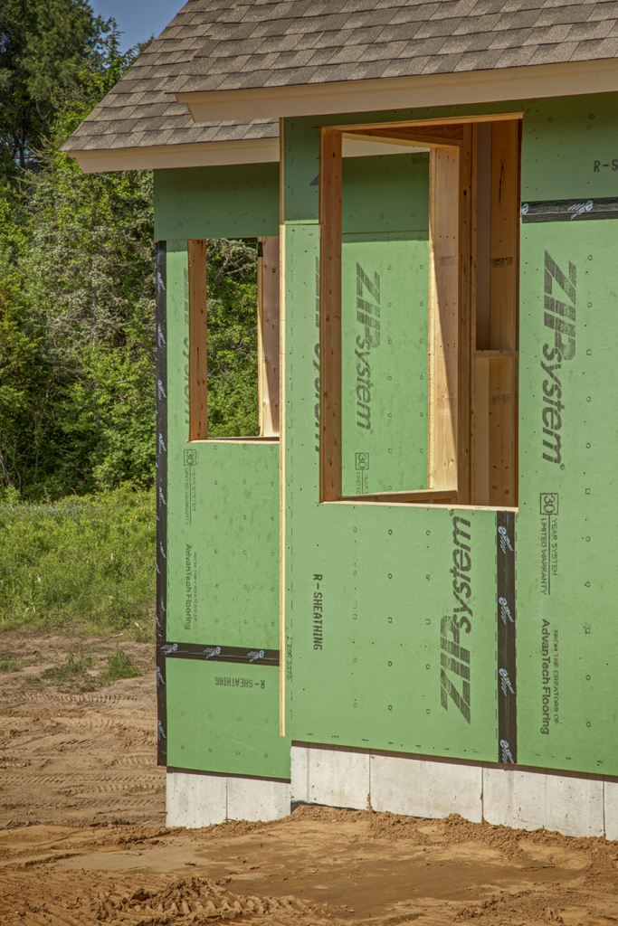 System replaces traditional sheathing and housewrap for for Sheathing house wrap