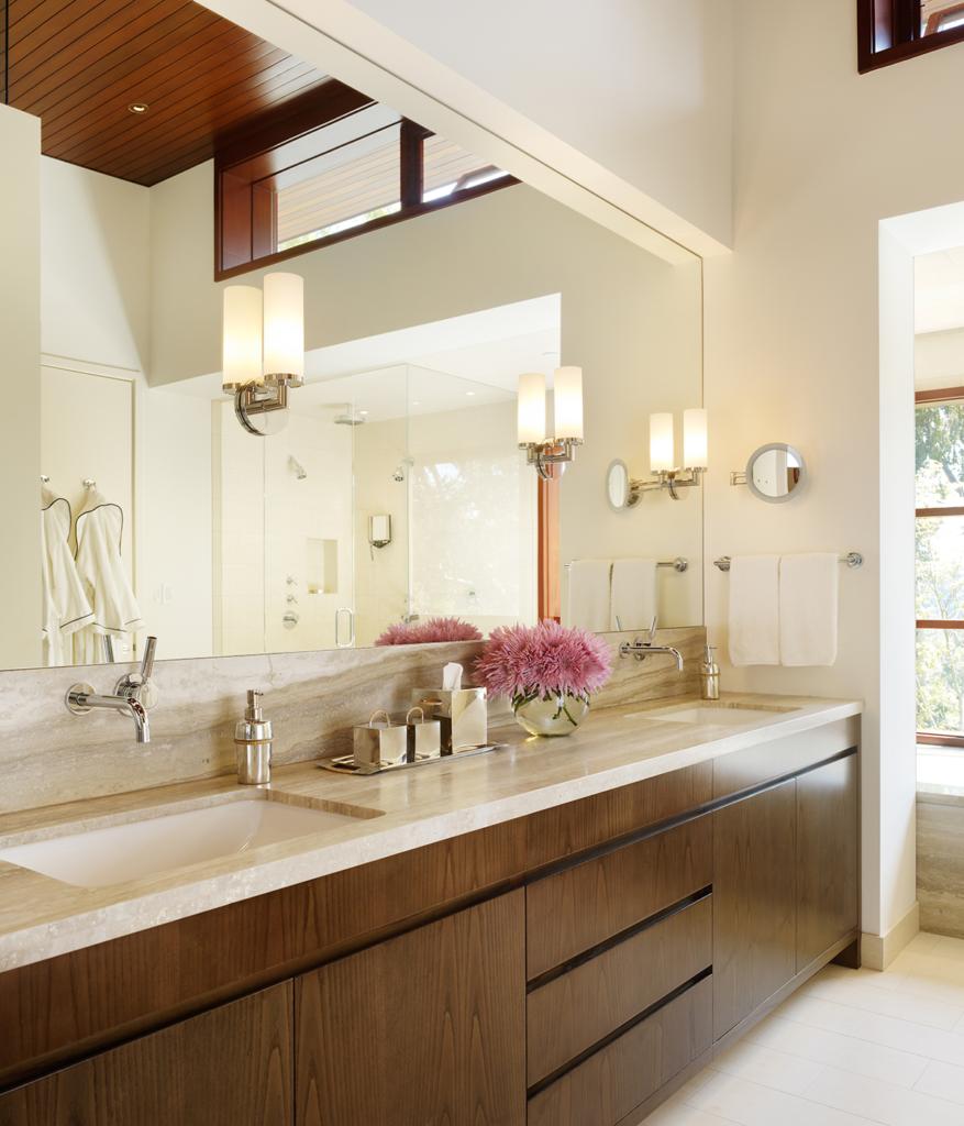 kgm lighting recessed lights mirrored sconces and natural light enhance bathroom design show caption hide caption