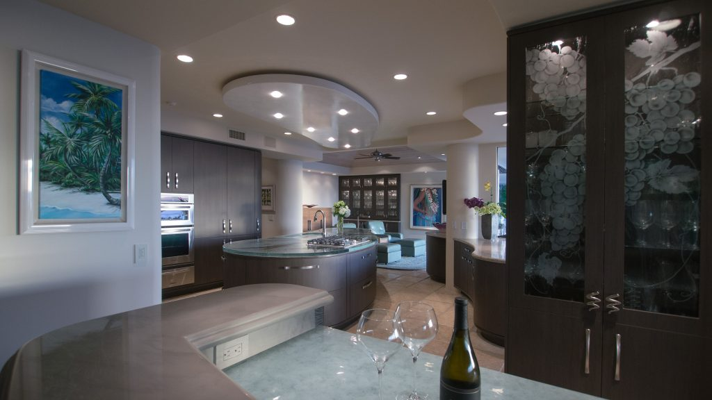 At The Bar, A Custom Glassworks Lower Glass Countertop Is Accented With A  Grey Glass Polished Quartzite Upper Counter. The Tall Cabinet Features  Etched ...